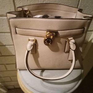 Michael kors purse brand knew